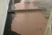 Leveling tile subfloor.