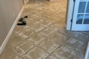 Grinding tile flooring.