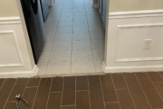 Tiled floors to be ground.