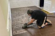 Tiled flooring being ground.
